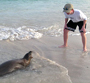 Michael Oren play with sea lion